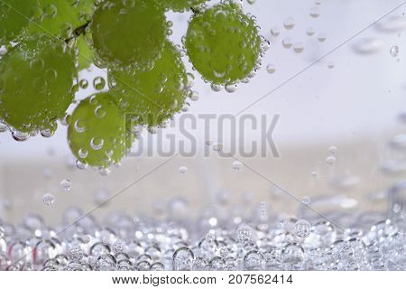 Berries of grapes of sultana in mineral water