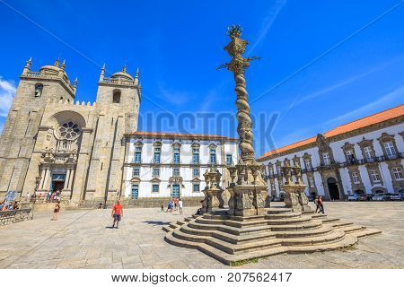 Porto, Portugal - August 11, 2017: romanesque and gothic architecture of Porto Cathedral or Se do Porto, Episcopal Palace and and Pillory or Pelourinho in historic center of Porto.Unesco Heritage Site