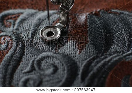 Multilayer embroidery on brown leatherette with embroidery machine