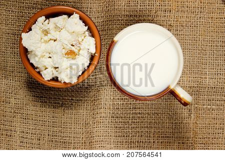 dairy products on burlap. Cottage cheese and milk. View from above
