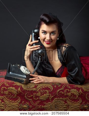 Woman In Lingerie With Old Phone.