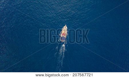 Aerial view of sailing boat on open sea. Bird eye view, water sport and relax