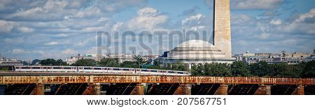 A train passing by the Washington and Jefferson Memorials in Washington DC.