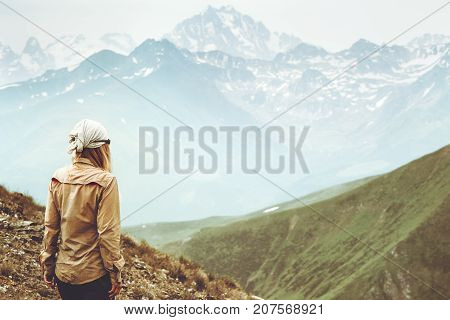 Woman traveler hiking at mountains landscape Travel Lifestyle wanderlust adventure concept summer vacations outdoor into the wild