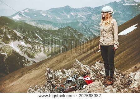 Woman backpacker at mountains Travel Lifestyle adventure wanderlust concept summer vacations hiking outdoor