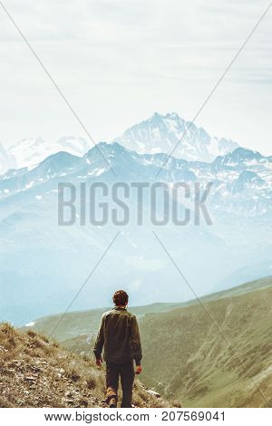Man hiker alone at mountains Travel Lifestyle concept adventure vacations outdoor