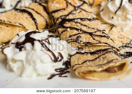 Sweet Pancake With Cream And Plasma Biscuit. Chocolate Overflow And Whipped Cream Over Pancake