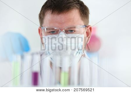Test tubes from a chemical laboratory on a table blurred against a white background with chemical reagents