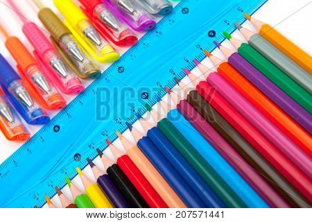 Various Pens and Pencils Isolated on White Background