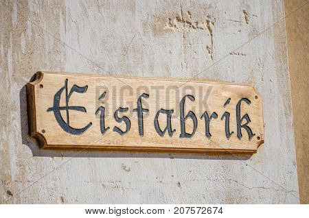 Wooden Eisfabrik or ice factory sign at ghost town Kolmanskop near Luderitz, Namibia, Southern Africa.