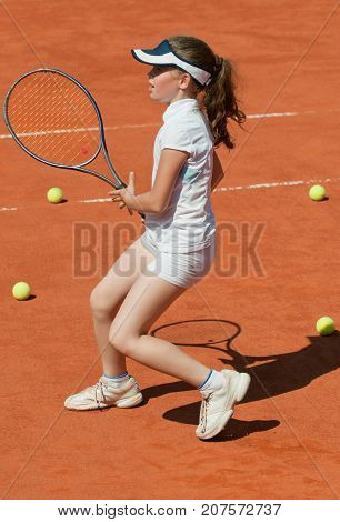 Female Tennis Player Standing On Clay Court, Toned Image