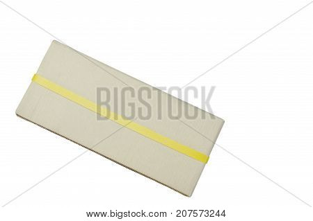 brown hard paper parcel wrapped by yellow plastic band on white background