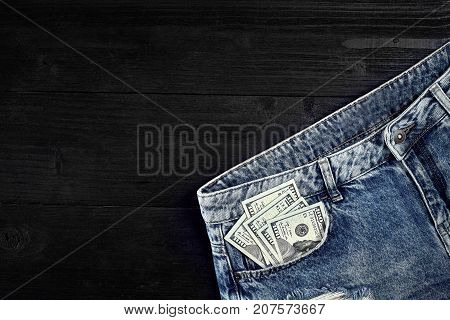 Cash in your jeans pocket. Still life. Copy space. Top view
