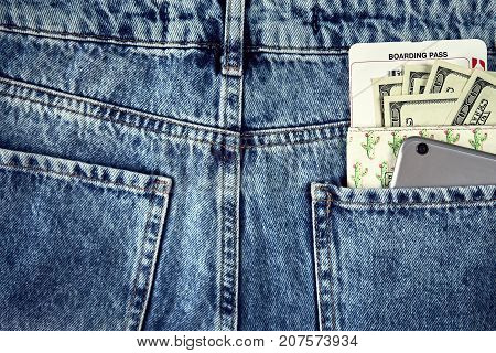 Cash and smart in your jeans pocket. Still life. Copy space. Top view