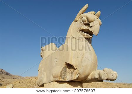 Two-headed Griffin statue in the ancient city of Persepolis, Iran. UNESCO World heritage site.