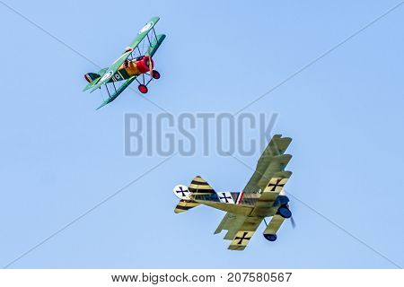 SLIAC SLOVAKIA - AUGUST 27: Dogfight between biplane and triplane at airshow SIAF 2017 on August 27 2017 in Sliac