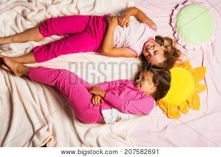 Kids In Pink Pajamas Put Heads Together