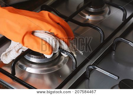Close Up View Of Hands In Rubber Gloves Cleaning Hob