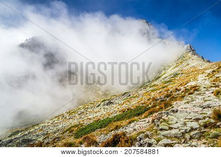 Cloud on the hill in High Tatras mountins Slovakia Hiking trail