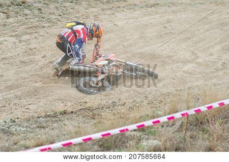 Ukraine Novgorod-Seversky - September 30 2017: Rally enduro motorcycle race on the sandy road locality near the city of Novgorod-Seversky