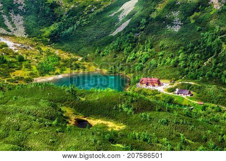 Tarn Zelene pleso and cottage in High Tatras mountains at Slovakia. Alpine summer mountains