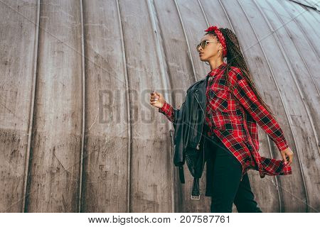 Girl In Leather Jacket And Checkered Shirt