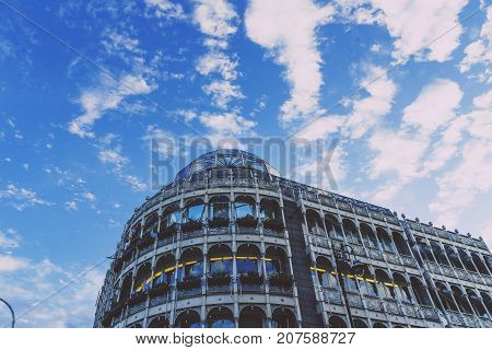 DUBLIN IRELAND - September 30th 2017: Stephen's Green shopping centre exterior architecture under a beautiful blue sky with fluffy clouds