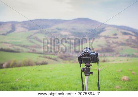 Professional Camera On Tripod On Mountain Background. Carpathians, Ukraine