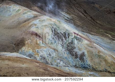 Ground in geothermal area contains different minerals and is multicolored.
