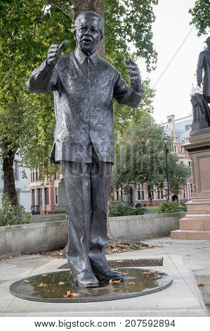 London 28th September 2017:-Statue of Nelson Mandela in Parliment Square opposite the Palace of Westminster