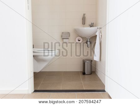 Hydrant And Sink In A Small Toilet