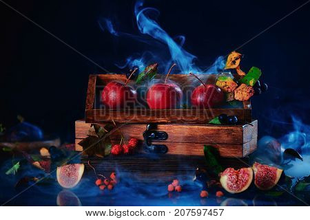 Three tiny apples in a wooden crate. Website header. Dark food photography with copy space.