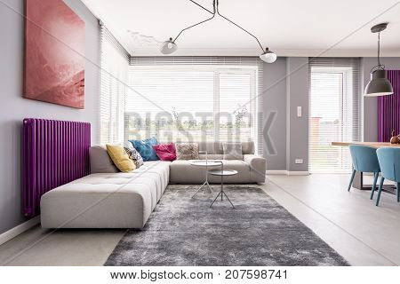 Abstract Painting Hanging Above Sofa