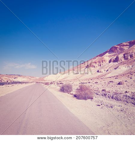 Asphalt Road in the Negev Desert in Israel Instagram Effect