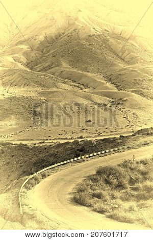 Winding Asphalt Road in the Negev Desert in Israel Vintage Style Toned Picture