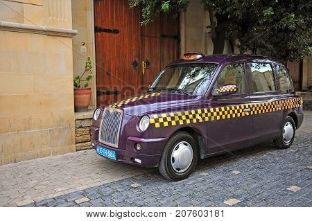 BAKU AZERBAIJAN - SEPTEMBER 26: Purple taxi cab in the street of Baku on September 26 2016.