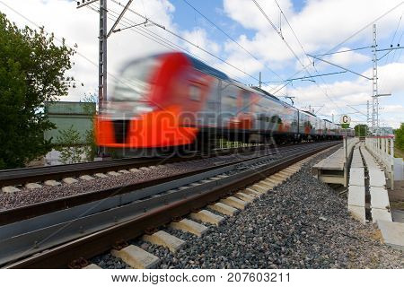 The train quickly travels along the Moscow Central Ring. Motion blur.
