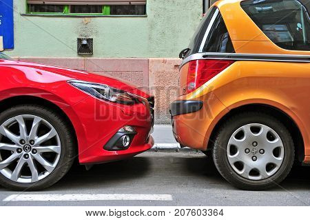 BUDAPEST HUNGARY - MAY 28: Two cars parked in the street of Budapest on May 28 2016.