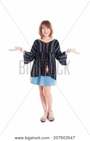 Full length of beautiful middle aged asian woman smiling over white background