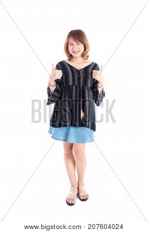 Full length of beautiful middle aged asian woman showing thumb up and smiling over white background