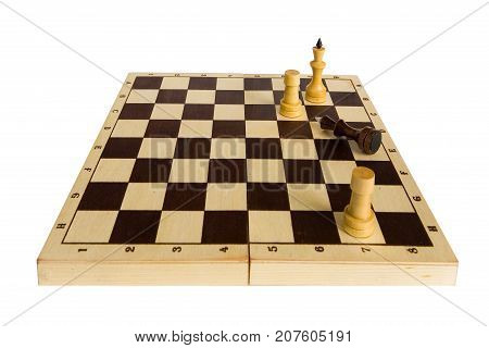 Chess. The Black King gave in and lies on the chessboard.