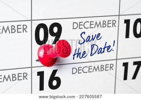Wall Calendar With A Red Pin - December 09