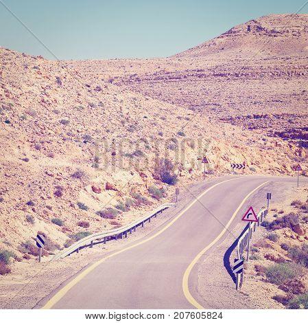 Winding Asphalt Road in the Negev Desert in Israel Instagram Effect
