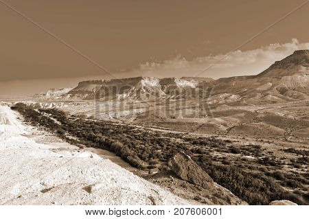 Rocky hills of the Negev Desert in Israel. Breathtaking landscape of the desert rock formations in the Southern Israel Desert. Vintage Style Sepia photo