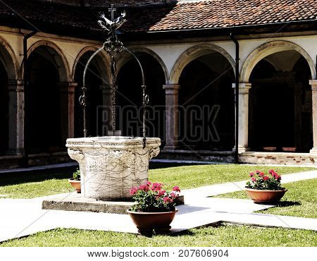 Well Inside A Cloister In The Ancient Franciscan Convent In Ital