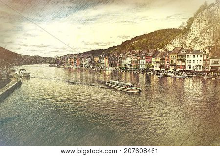 Embankment of the River Meuse in the Belgian City of Dinant. Beautiful small town Dinant in Belgium. Vintage style toned picture