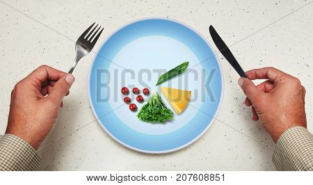 tableware in hands and vegetarian food on a plate