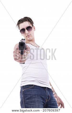 Bad guy pointing handgun isolated on white background.