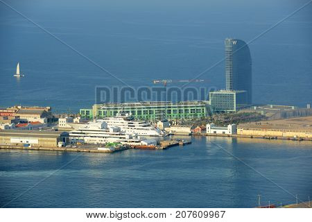 BARCELONA - JUN. 11, 2013: W Barcelona (Hotel Vela) at Port of Barcelona, viewed from Montjuic, Barcelona, Catalonia, Spain.