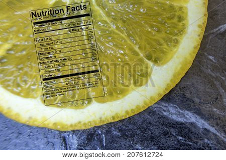 Orange Slice With Nutrition Label On Black